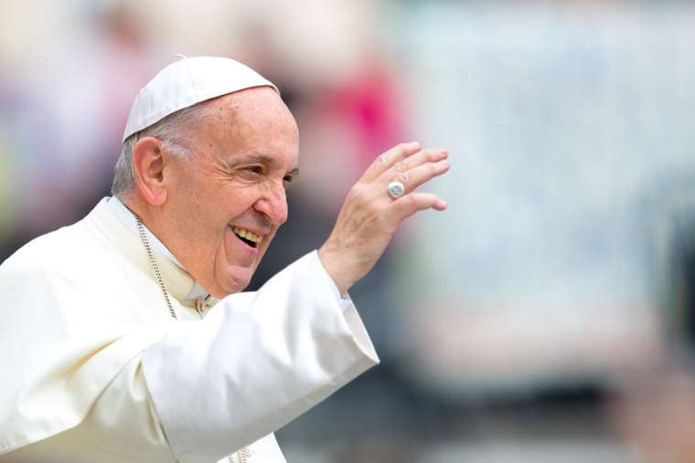Pope Francis greets the faithful at the general audience May 23.
