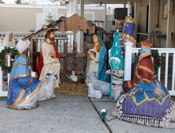 The Nativity scene is currently on display at Grotto Pizza.