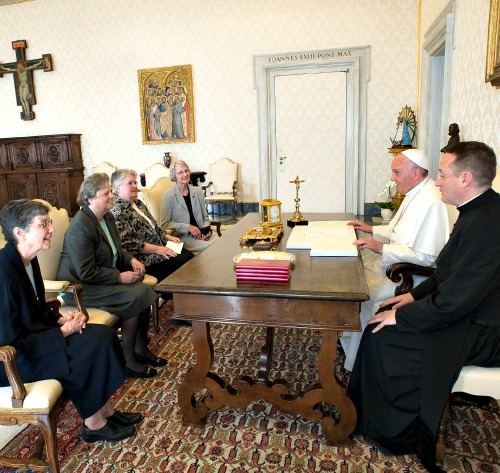 Pope Francis talks with a delegation of The Leadership Conference of Women Religious during an audience at the Vatican on April 16.