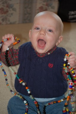 James holds a 14-foot-long strand of colorful beads, each with a color-coded meaning, that record the days he spent in the hospital.  A beautiful, glass, heart-shaped bead marks the day James received his new heart.