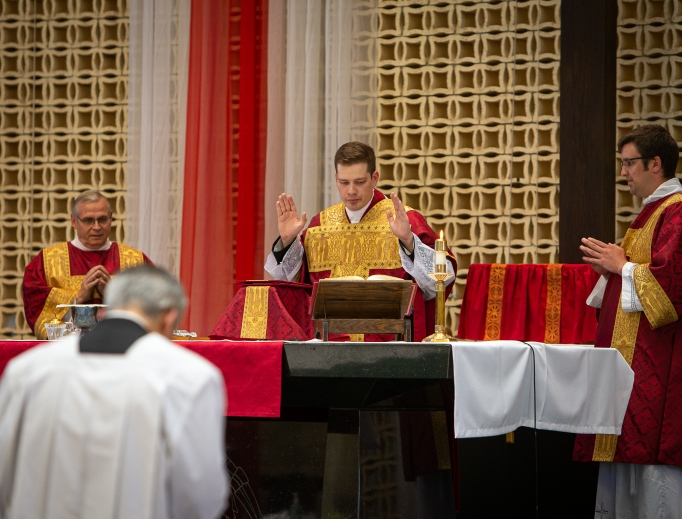 Above, Father Paul Hedman celebrates his first Mass on May 31.