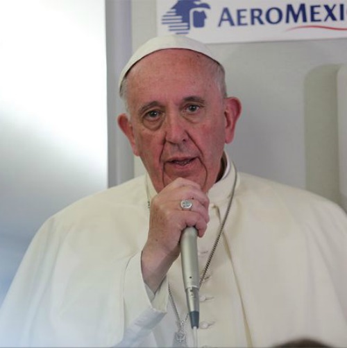 Pope Francis aboard the papal flight from Mexico to Rome on Feb. 17, 2016.