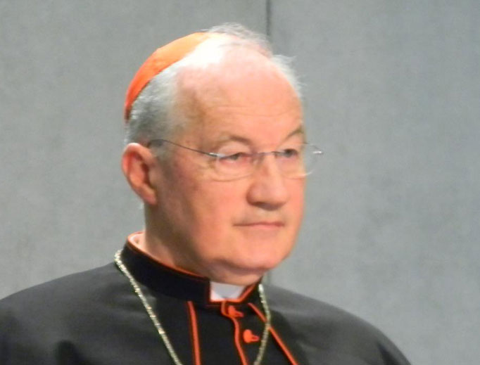 Cardinal Marc Ouellet, prefect of the Congregation for Bishops, listens to a statement at a 2011 press conference.