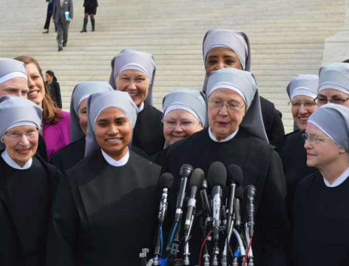 Little Sisters of the Poor gather outside the Supreme Court where oral arguments were heard on March 23, 2016, in the Zubik v. Burwell case.