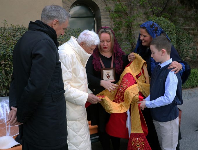 ABOVE: Clare Short from Di Clara presents Pope Emeritus Benedict his 90th Birthday vestment set with a design based on Our Lady of Altötting. BELOW: (1) Making the front section of the chasuble. (2) Our Lady of Altötting. (3-5) Fresh water pearls and garnet stones were used to embellish the embroidery. (6) Pope Emeritus Benedict's coat of arms. (7-8) The 5 piece set including chasuble, stole, maniple, chalice veil and burse. (9) Part of the embroidered inscription from the lining of the chasuble. (10) Left to right: Pope Emeritus Benedict, Alessandra Dee Crespo, Clare Short and Alex Short.