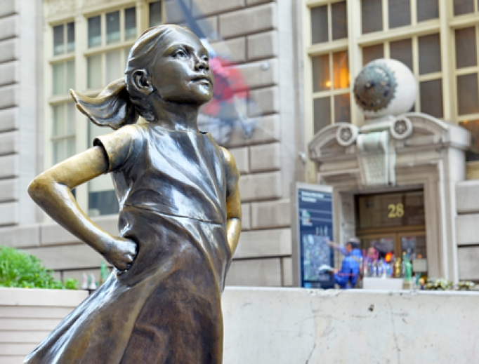 Statue of a fearless girl opposite the Charging Bull in lower Manhattan, 2018.