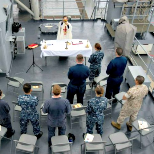 US Navy Chaplain Lt. Tung Tran says Mass aboard the USS Rushmore, June 21, 2014.
