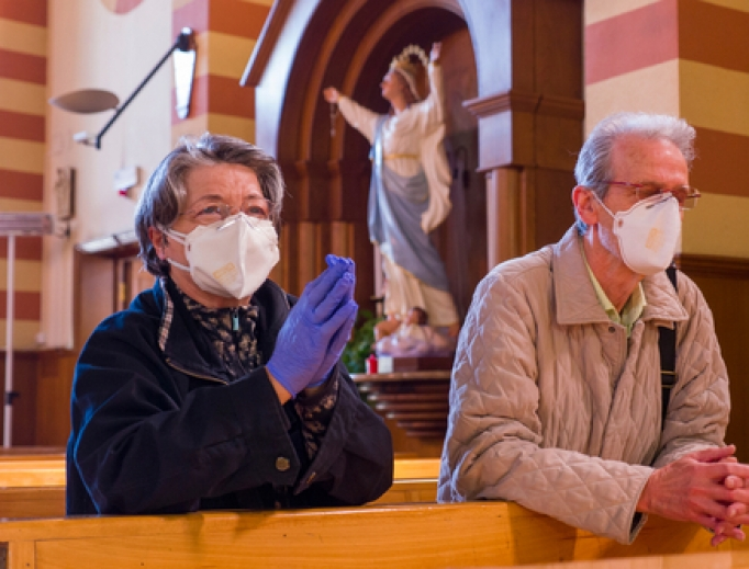 A couple prays in the church of San Giuseppe dei Falegnami in Rome during the coronavirus lockdown taking advantage of the few hours of opening of the church, April 11, 2020.
