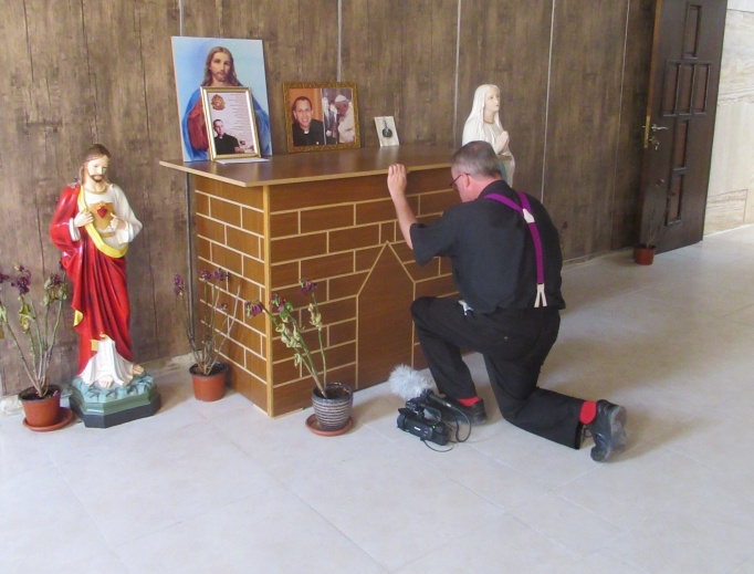 Father Benedict Kiely prays at the tomb in Karamlesh of Chaldean Father Ragheed Ganni, who was martyted in 2007; below, he meets with Chaldean Archbishop Bashar Warda of Erbil and  Yazidi spiritual leader Baba Sheikh (c) and Qaraqosh Syriac Catholic native Yohanna Towaya (l).