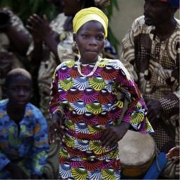 A girl dances while waiting for the arrival of Pope Benedict XVI in Benin's main city Cotonou, Nov18. Pope Benedict, arriving on his second trip to Africa as Roman Catholic leader, on Friday urged African nations to resist the temptation to surrender to market forces as they grow and modernize.