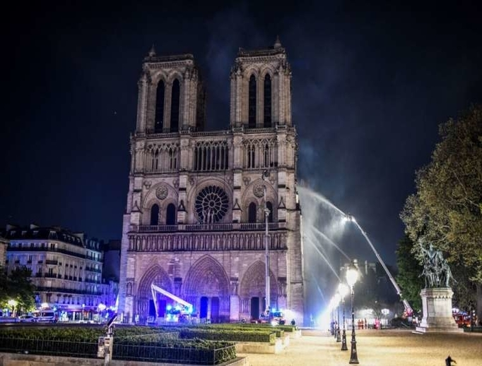 Firefighters respond to a major fire at Notre Dame cathedral in Paris, April 15, 2019.