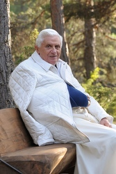 Pope Benedict sits on a bench during vacation in the Italian Alps. (CNS photo)