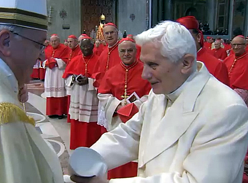 Benedict XVI greeting Pope Francis in St. Peter's basilica on Saturday.