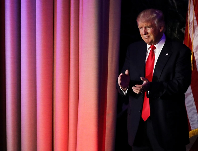 Republican president-elect Donald Trump acknowledges the crowd during his election night event at the New York Hilton Midtown in the early morning hours of Nov. 9 in New York City.