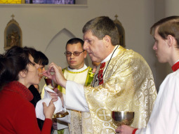 Father Daniel Maurer distributes Communion at the mission of Most Holy Mother of God Church in Vladivostok, Russia.