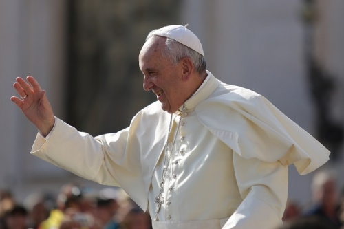 Pope Francis greets pilgrims in St. Peter's Square during his Sept. 9 general audience.