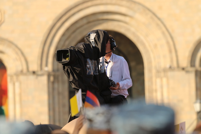 A cameraman filming events during Pope Francis' visit to Armenia, June 25, 2016.