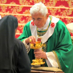 Pope Benedict XVI gives Communion to a woman religious Oct. 28 at the closing Mass of the Synod of Bishops for the New Evangelization.