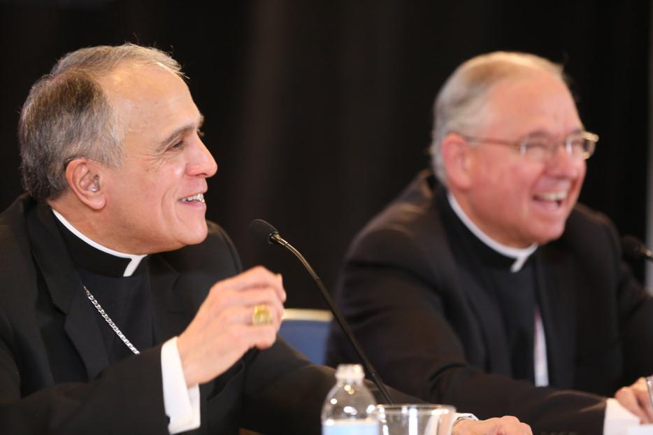 Cardinal Daniel DiNardo (left) and Archbishop José Gómez, president and vice-president of the USCCB at the spring meeting in Indianapolis.