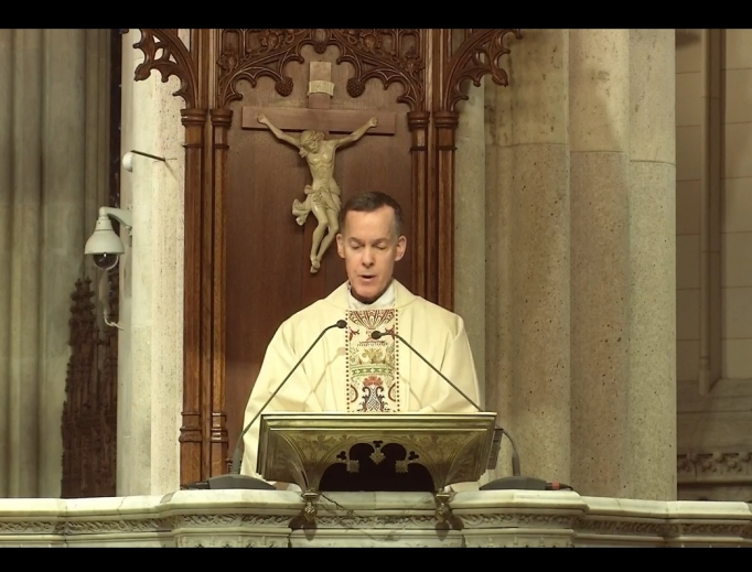 Father Donald Haggerty participates in the livestreamed Easter Sunday Mass from St. Patrick's Cathedral in New York City on April 12.