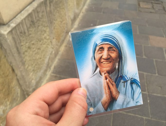A prayer card of Blessed Mother Teresa being handed out by the Missionaries of Charity to pilgrims at World Youth Day in Krakow, Poland.