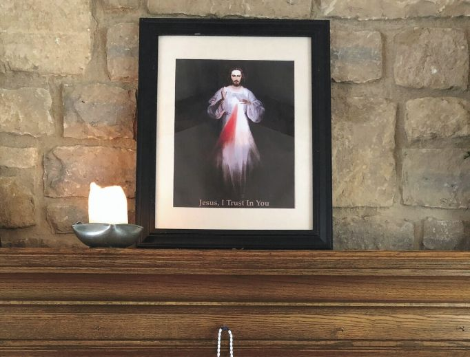 The Jaminet family fosters their devotion to Divine Mercy with prayerful images and times of prayer.
