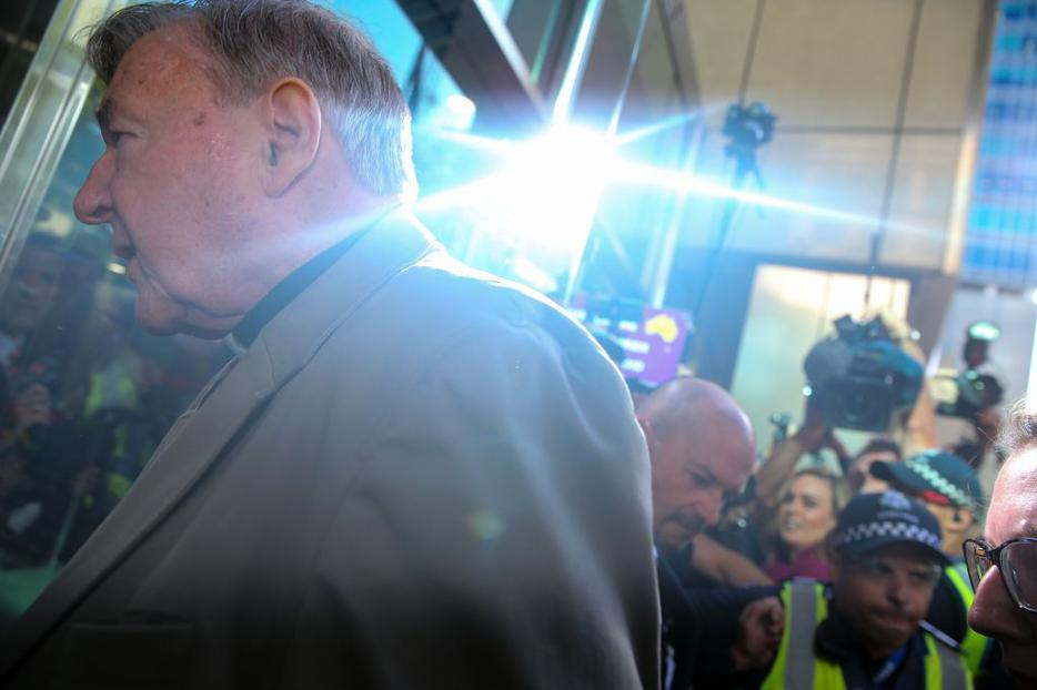 Cardinal George Pell makes his way to court in Melbourne, Australia, Feb. 27.