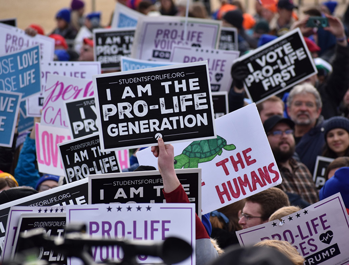 Marchers carry signs at the 2020 March for Life in Washington, DC, on Jan. 24, 2020.