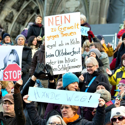 """Women protest against the New Year's Eve attacks on women by Muslim refugees near the cathedral in Cologne, Germany. The sign says, """"No to violence against women, whether in Cologne, at Oktoberfest, or in the house or bedroom."""""""