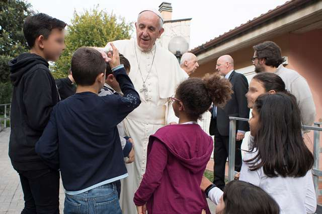 Pope Francis visits children at the SOS Village in Rome Oct. 14.