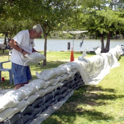 Dan McCloy places sandbags around his home located on Bayou Melhomme in Stephensville, La., May 14. This small community north of Morgan City is in the flood plain of the Morganza spillway. With the continuing release of water from the swollen Mississippi through the spillway, the river was expected to top out at 45 feet at Baton Rouge, La.