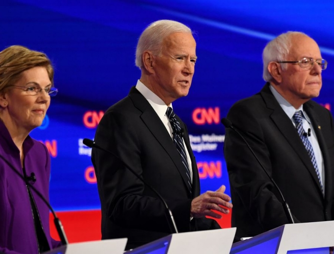 Democratic presidential hopefuls Massachusetts Sen. Elizabeth Warren, l, former Vice President Joe Biden, c, and Vermont Sen. Bernie Sanders participate in the seventh Democratic primary debate of the 2020 presidential campaign season co-hosted by CNN and the Des Moines Register at Drake University in Des Moines, Iowa, on Jan. 14.