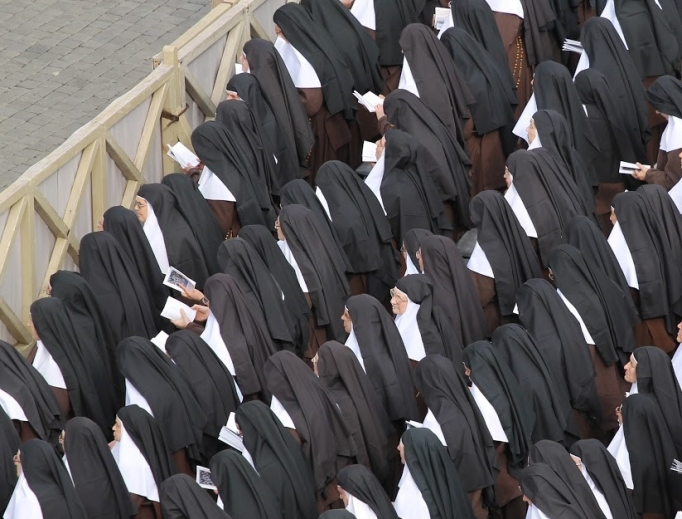 Nuns attend the canonization Mass of Louis and Zélie Martin, Father Vincenzo Grossi and Sister Maria of the Immaculate Conception on Oct. 18, 2015, in St. Peter's Square.