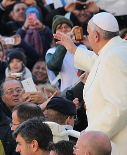 Pope Francis greets pilgrims in St. Peter's Square.