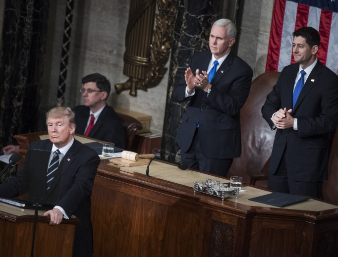 President Donald Trump addresses a joint session of Congress in the Capitol House Chamber, as Speaker Paul Ryan, R-Wis., right, and Vice President Mike Pence look on, Feb. 28.