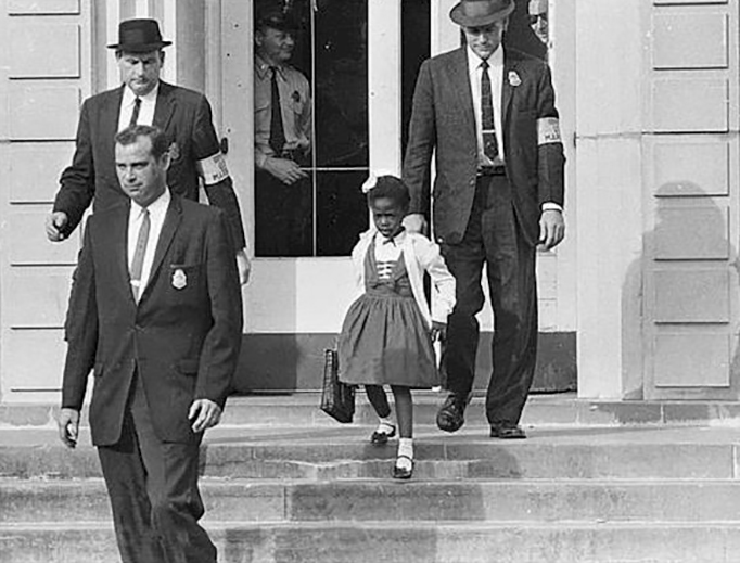 U.S. Marshals protect Ruby Bridges as she leaves her New Orleans school in 1960.