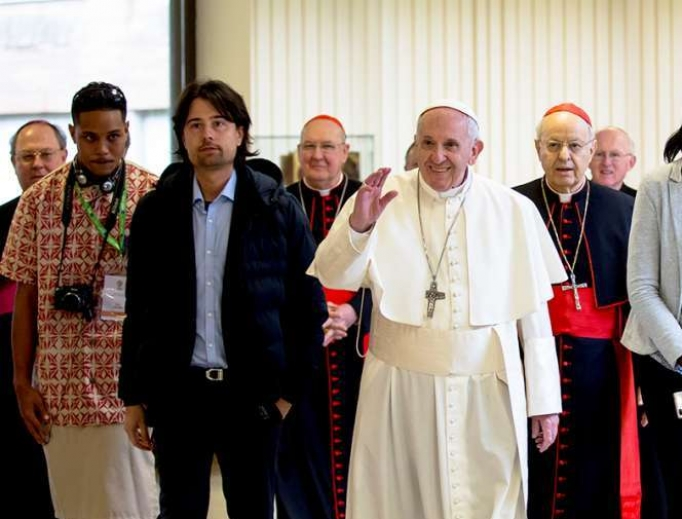Pope Francis stands with delegates at the Vatican's pre-synodal youth meeting in March.