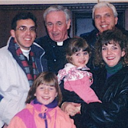 Father Mychal Judge with the Lynch family in the early 1990s. Kelly Ann, at right, holds daughter Shannon.