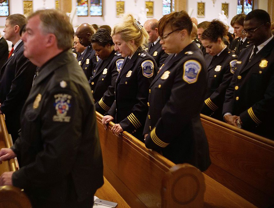 Police attend the annual Blue Mass at Saint Patrick's Catholic Church, May 5, 2015, in Washington, D.C. The Blue Mass is held annually for those in law enforcement and first responders.