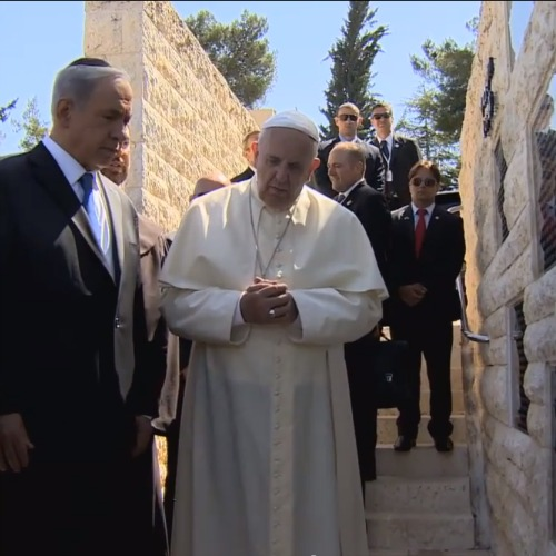 Israeli Prime Minister Benjamin Netanyahu listens while Pope Francis offers a prayer May 26 at an Israeli monument to terrorist victims.