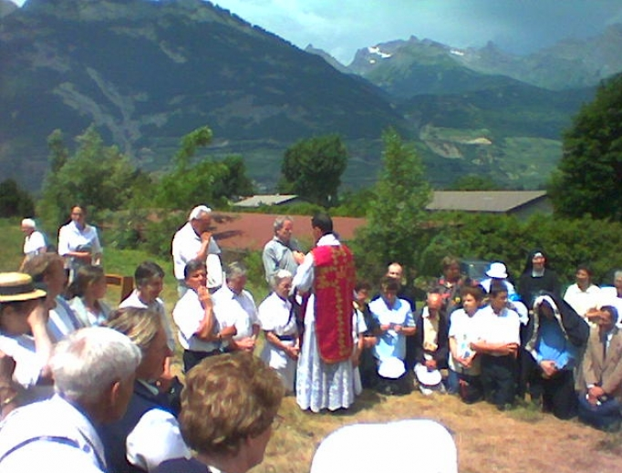 A priest giving blessings after ordination at the International Seminary of Saint Pius X, in Écône, Switzerland.