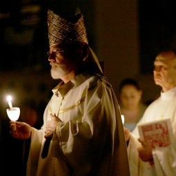 LEADING THE WAY. Cardinal Seán O'Malley of Boston holds a candle as he leads a procession during an Easter Vigil service at the Cathedral of the Holy Cross in 2006 in Boston.