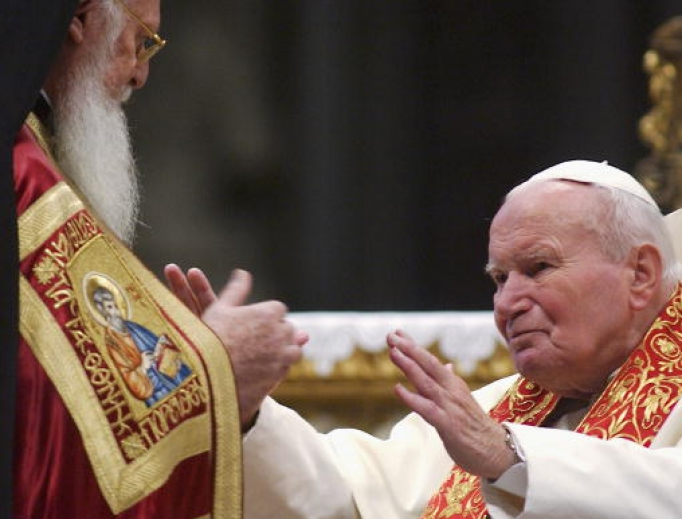 Pope John Paul II embraces Orthodox Patriarch of Constantinople Bartholomew I during an ecumenical celebration at St. Peter's Basilica on Nov. 27, 2004, in Vatican City. The Pope also returned relics of two early Christian saints, aiming to establish unity among the two Christian churches.