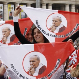 Pilgrims hold handkerchiefs featuring Blessed Pope John Paul II before the start of a Mass of thanksgiving in celebration of his beatification in St. Peter's Square at the Vatican May 2. The Mass was celebrated by Cardinal Tarcisio Bertone, the Vatican's secretary of state.