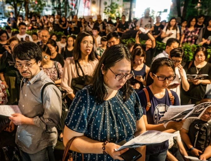 Hundreds of residents gather around for a prayer meeting outside the Court of Final Appeal on June 19 in Hong Kong. Hong Kong Chief Executive Carrie Lam issued a formal apology but added that the controversial extradition bill would not be scrapped two days after almost 2 million people marched in the city to demand for her to step down and withdraw the bill.