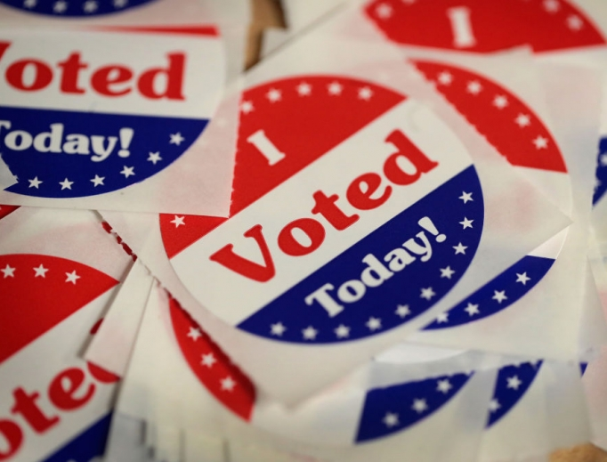 Stickers are made available to voters who cast a ballot in the midterm elections at the Polk County Election Office Oct. 8 in Des Moines, Iowa. Oct. 8 was the first day of early voting in the state.