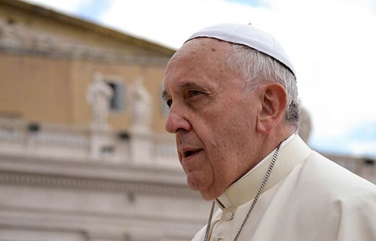 Pope Francis greets pilgrims in St. Peter's Square during the Wednesday general audience on May 28, 2014.