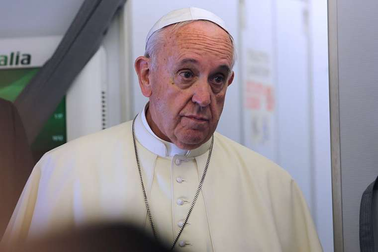 Pope Francis speaks aboard a flight from Italy to Ecuador July 5, 2015.