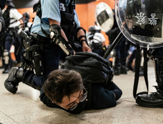 A Hong Kong protester is detained by police at Po Lam Station on Sept. 5, 2019 in Hong Kong, China. Pro-democracy protesters have continued demonstrations across Hong Kong since 9 June against a controversial bill that allows extraditions to mainland China, as the ongoing protests, many ending up in violent clashes with the police.
