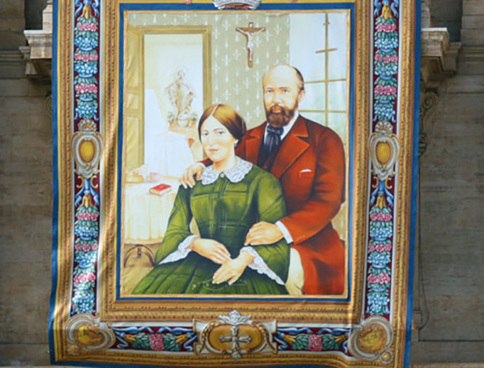 The portrait of Louis and Zélie Martin, parents of St. Thérèse of Lisieux, hangs from the balcony of St. Peter's Basilica before their canonization ceremony Oct. 18, 2015.